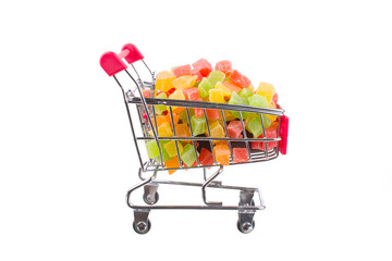 a bunch of candied fruits in a shopping trolley