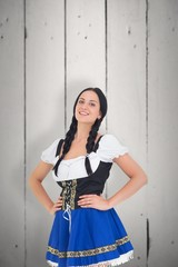 Composite image of pretty oktoberfest girl smiling at camera