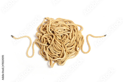 Leinwanddruck Bild Ball of hemp rope isolated on white background.