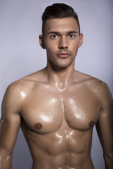 sexy sportive man with naked tanned torso