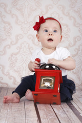 Cute little baby girl playing  with coffee grinder