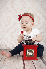 Little baby girl with coffee grinder