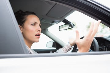 Pretty businesswoman experiencing road rage