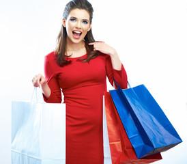 Shopping woman portrait isolated. White background. Happy shopp