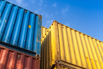 Colorful cargo containers are stacked in the storage area