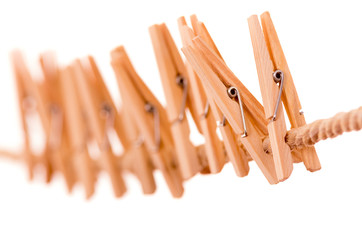 wooden clothespins hanging on rope