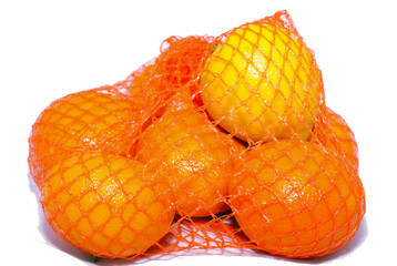 tangerines on a white background in a string bag,