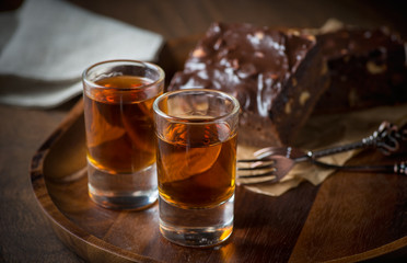 Glass of rum on wooden tray