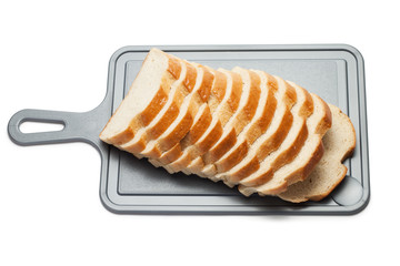 sliced bread on breadboard isolated over white