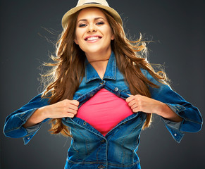 smiling woman ripping clothes on chest. copy space for advertis
