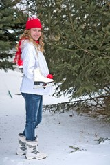 young teen girl with ice skates