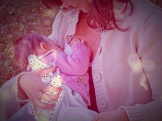 brunette woman breastfeeding