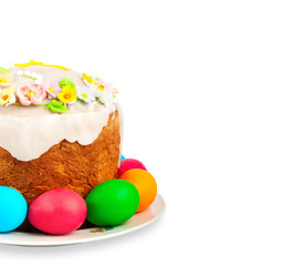 Painted Easter eggs and delicious cupcake on white isolated back