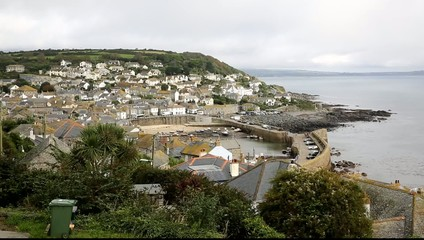 Mousehole harbour and fishing village Cornwall England UK
