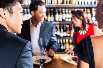Asian friends celebrating in restaurant