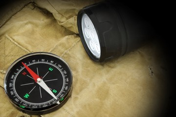 Searchlight and Compass on Backpack