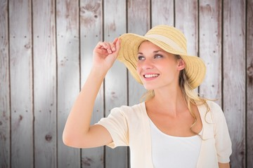 Composite image of attractive young blonde smiling in sunhat