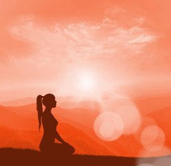 Yoga and meditation. Woman silhouette.