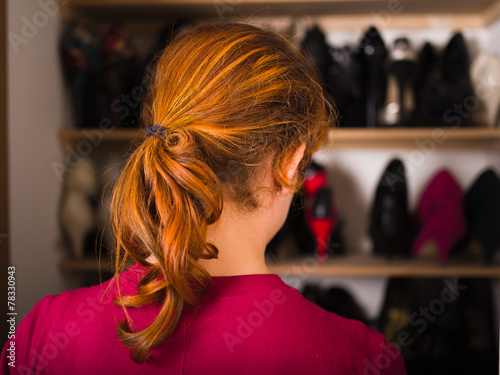 canvas print picture Woman organizing her shoes