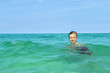 handsome teen has fun swimming in the ocean