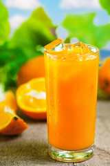 Orange juice in glass, fresh cold drink with ice