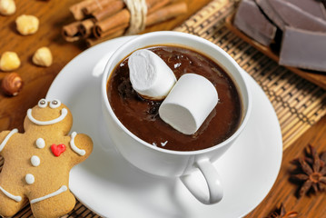 Hot chocolate with marshmallow and gingerbread cookie
