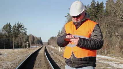 Railway engineer worked with tablet PC on the railway