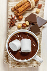 Hot chocolate with marshmallows, cinnamon, anise and nuts