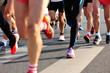 marathon runner legs running on city street - 78336124