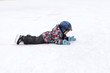Child lying on the rink