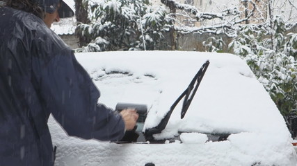 Man Remove Snow From his Car
