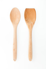 Wooden ladle and spatula on white background, kitchen utensils