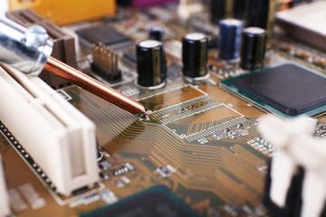 Repairing of computer motherboard, macro view