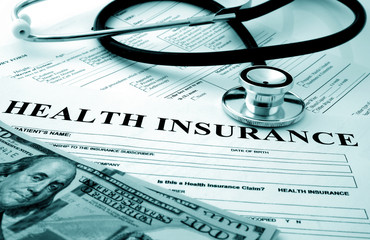 Health insurance form with money and stethoscope