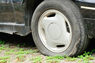 flat tyre on car wheel