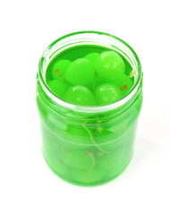 Homemade jar of green maraschino cherry isolated