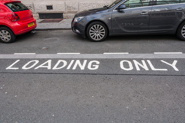 Loading only bay with cars illegally parked in it, Liverpool, UK
