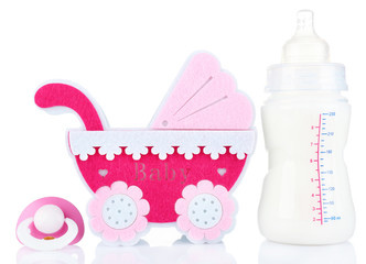 Baby milk bottle, pram and pacifier isolated on white