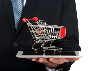 Close up man holding shopping cart on tablet