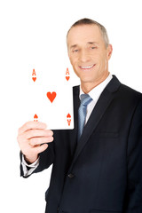Elegant businessman with red ace card