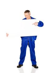 Happy worker presenting empty banner