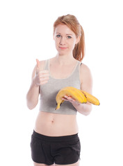 Athletic girl with bananas in hand