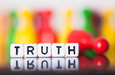 Cube letters show the word truth