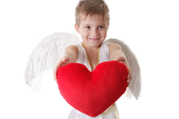 Happy cupid boy with wings holding red plush heart