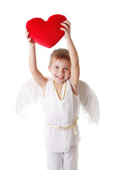 Cupid boy with wings showing red pillow heart