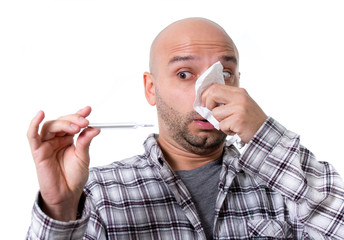 sick man in flu holding thermometer checking fever