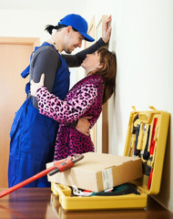 Plumber having flirt with young girl
