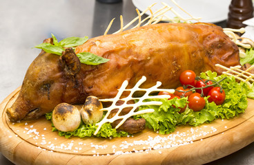 roasted pig with herbs and vegetables cook