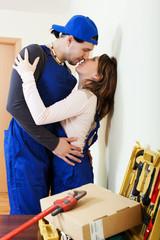 Service man and woman flirting