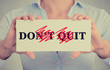 Closeup woman hands holding sign don't quit do it message